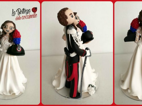 cake topper in divisa
